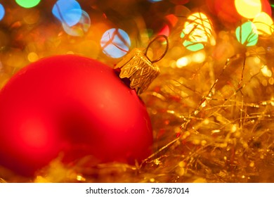 Red Christmas tree decorations on lights background