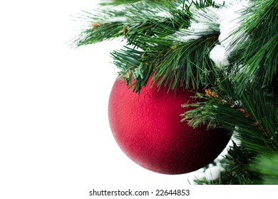 Red christmas-tree decoration with green needles isolated on white