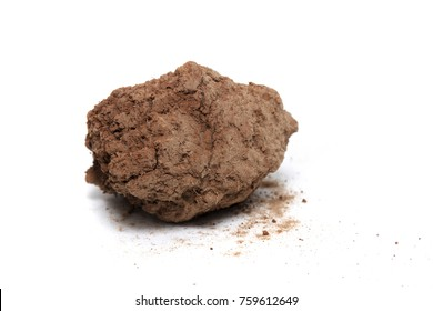 red chunk of barren clay isolated on a white background.