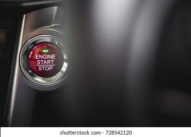 Red circle button in a car for start and stop engine with copy space