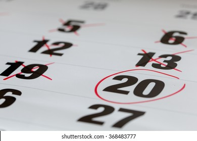 Red circle marked on a calendar and X Mark for counting down. concept for an important day.