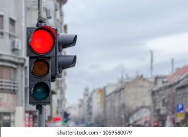 Red city urban semaphore light with blury background