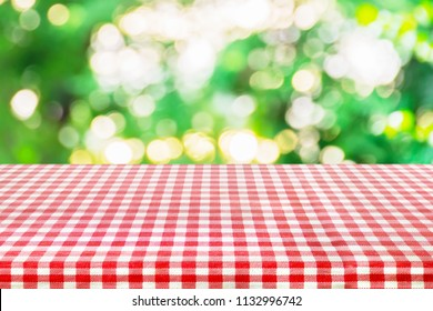 Red classic checkered table cloth with astract bokeh background.