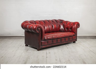 red classic chesterfield sofa in warehouse