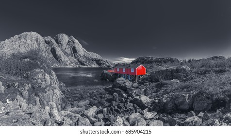Red Classic Norwegian Rorbu fishing hut on Lofoten islands, Norwegian traditional type of house used by fishermen - Black And White Toned
