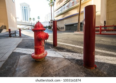 Red classic USA fire hydrant with protection on city street
