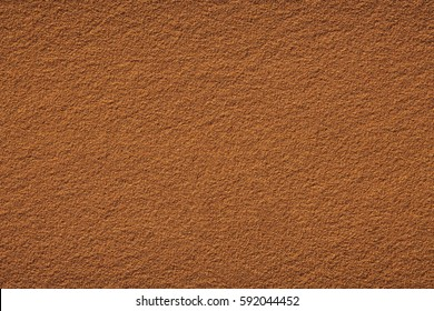 Red clay court tennis background texture. Tennis court close-up of gravel surface