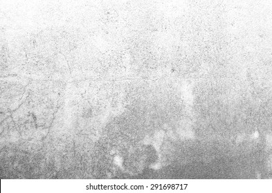Red clay stains on the white concrete wall.