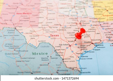 Red clerical needle on a map of USA, Texas and the capital Austin. Closeup Map Texas with Red Tack, US map pin