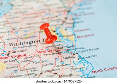 Red clerical needle on a map of USA, South Virginia and the capital Richmond. Close up map of South Virginia with red tack