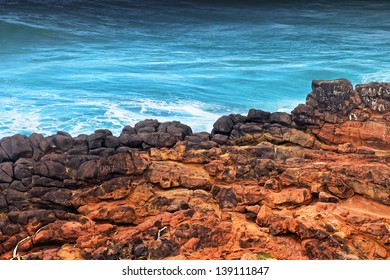 Red cliff and blue ocean in Australia