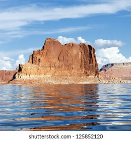 Red cliff reflected in the smooth water of the lake Powell