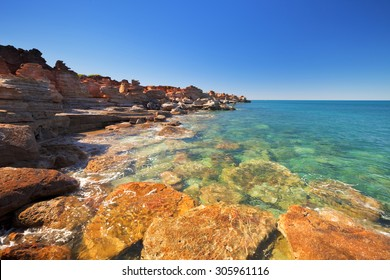 Red cliffs at Gantheaume Point, Broome, Western Australia on a bright and sunny day.