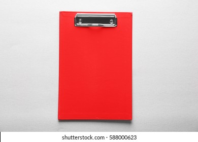 Red clipboard on light background