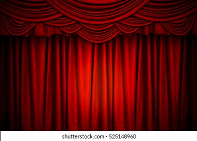 Red closed curtain with light spots on the stage for the background.