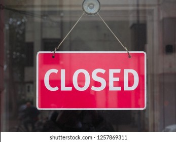 red closed sign in a shop window