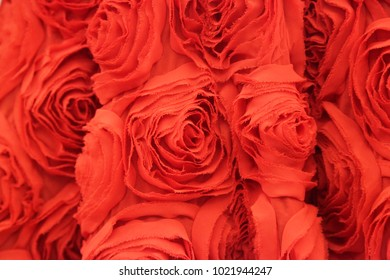 Red cloth. Abstract floral ornament.  Background of red rose pattern