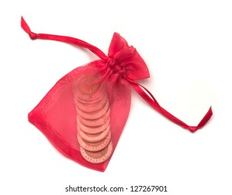 red cloth bag with coin inside on white background