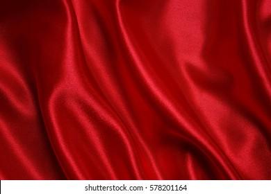Red cloth waves background texture.