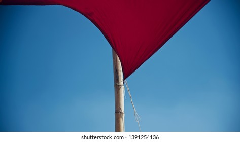 A red clothes tied with a bamboo isolated unique photo