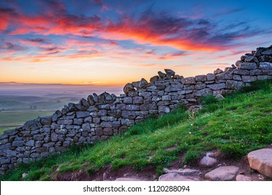 Red Clouds above Hadrian's Wall, a World Heritage Site in the beautiful Northumberland National Park. Popular with walkers along the Hadrian's Wall Path and Pennine Way