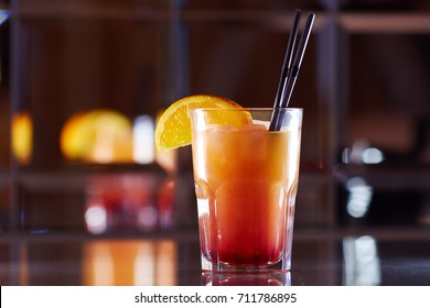 red cocktail in a bar on a mirror background