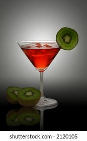 red cocktail with kiwi and ice