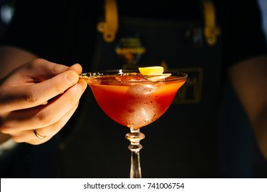Red cocktail with little orange