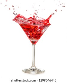 red cocktail splashing in martini glass isolated on white
