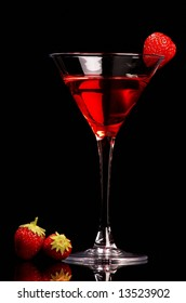 Red cocktail with strawberries on black background