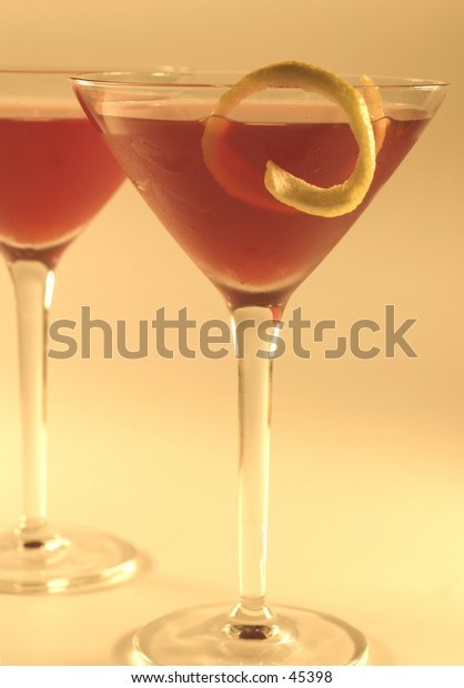 Red cocktails in martini glasses.