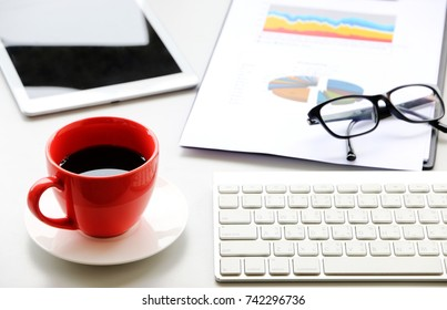 Red Coffee Cup on the desk Business Workspace background in Office Morning work