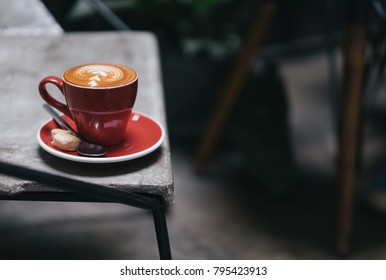 red coffee cup on the table