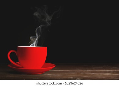 Red coffee cup On wooden a black background