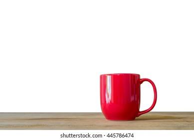 Red coffee mug on wooden