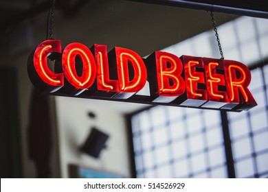 Red cold beer neon sign at bar entrance in New York