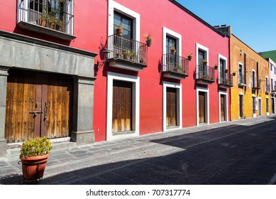 Red colonial architecture on a historic street in Puebla, Mexico