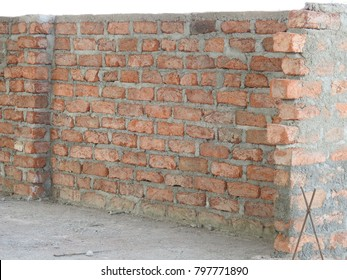 Red color Bricks arranged in row structure, cement and brick Wall texture closeup