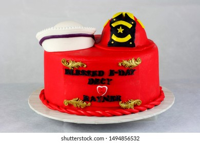 Red color cake fondant cover with fire fighter hat and nurse cap on top