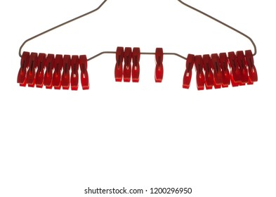Red color clothespins with hanger isolated on white background with space for text.
