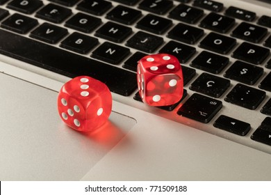 red color dice on keyboard close up
