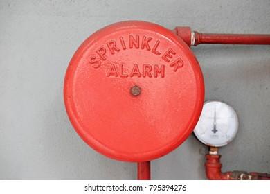 A red color fire sprinkler alarm bell.