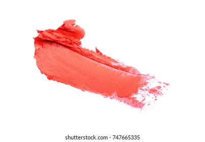 Red color lipstick stroke for makeup as sample of cosmetic product isolated on white background