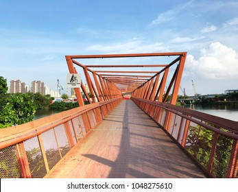 Red color Lorong Halus Bridge at Punggol Waterways, Singapore - front view