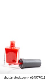 Red color nail polish   isolated on white