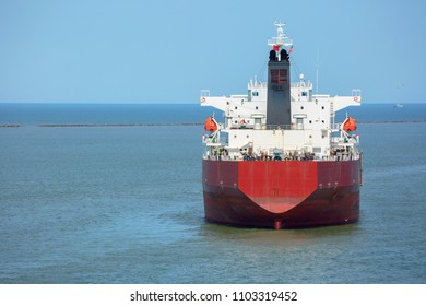 Red color oil product tanker at anchor in the port of Houston.
