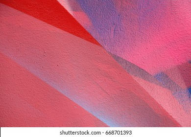 Red color palette. Colorful graffiti on the wall. Fragment for background. Detail of a graffiti. Street art
