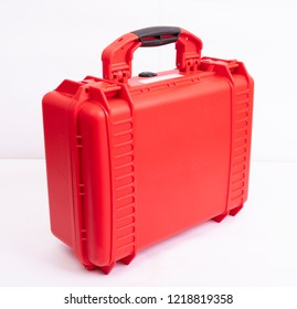 Red color plastic hard case on white background.