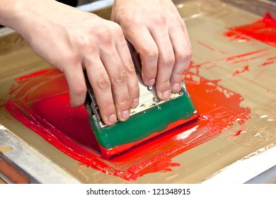 red color is printing on t-shirt with hands pressure