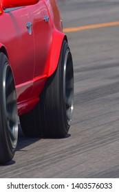 Red color race car sport wheel motion blur on road track transportation.